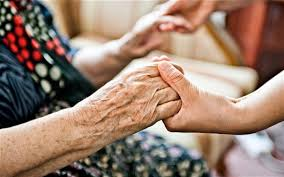 Hand holding with old person